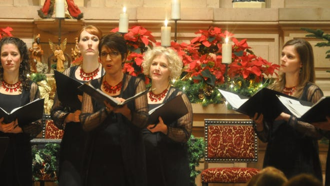 """Salem native Rita Litchfield-Good, center, sings a solo in Benjamin Britten's """"Ceremony of Carols"""" with the Phoenix Chorale in 2013.  The chorale's recording """"Rachmaninoff: All-night Vigil"""" won a 2016 Grammy for Best Choral Performance. Litchfield-Good graduated from South Salem High School in 1983."""
