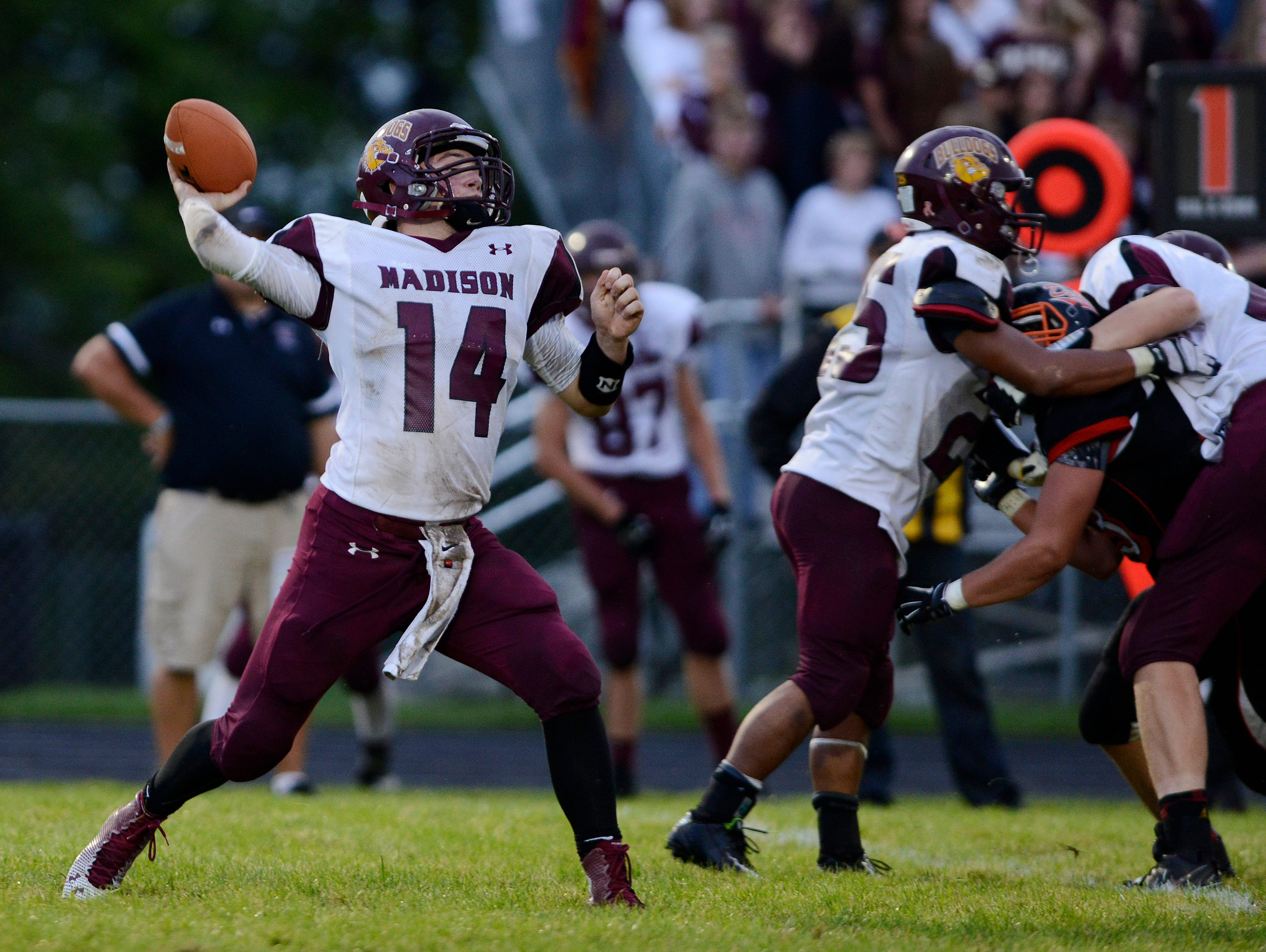 Madison senior quarterback Mitch Hansen throws a pass during Friday's game against Dell Rapids. Hansen was a dual threat for the Bulldogs, passing for 177 yards and rushing for 196 yards. Madison defeated Dell Rapids 36-33.