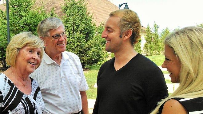 Prince Mario-Max Schaumburg-Lippe (in dark shirt) tours the Celebration Farm complex with Iowa City hosts Tom and Berth Ann Werderitsch and their daughter Jennifer.