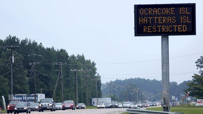 A sign in Moyock, N.C., warns travelers that access to both Hatteras and Ocracoke Islands is restricted to residents only on July 29, 2017.