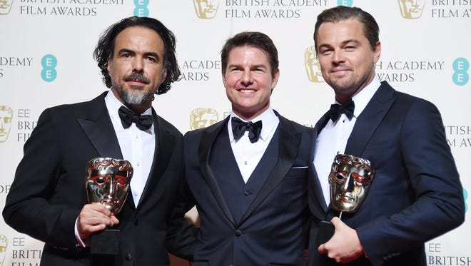 'The Revenant' best director winner Alejandro Gonzalez Inarritu, left, joins presenter Tom Cruise and best actor winner Leonardo DiCaprio backstage at the BAFTA British Film Awards in London on Sunday.