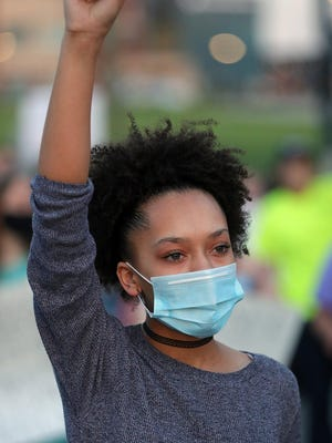 """Ryanne Helms of Akron said she didn't always feel like she """"had a right"""" to speak out against racism. On Wednesday, she said people need to stop being silent and use their voices to effect change."""