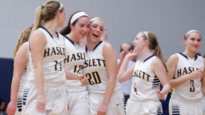 Haslett players Alexandria Trosko, from left, Megan Mowid, Annisa Whims (20), Taylor Rahl and Madelyn Lampman (3) celebrate their 59-51 win over DeWitt Friday, Jan. 15, 2016, in Haslett, Mich.