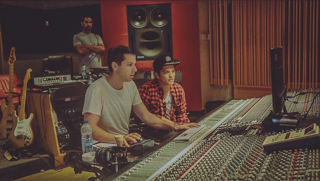 Mark Ronson, left, and Bruno Mars in the studio, working on Ronson's forthcoming 'Uptown Special' album, out Jan. 27 on RCA Records.
