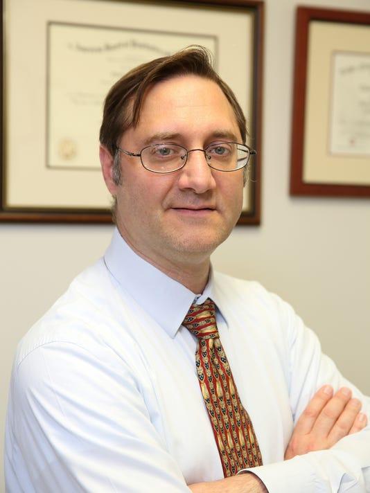 Dr. Charles Asta