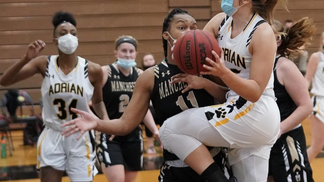Adrian's Rachel Bucher goes up for a layup during Saturday's game against Manchester.