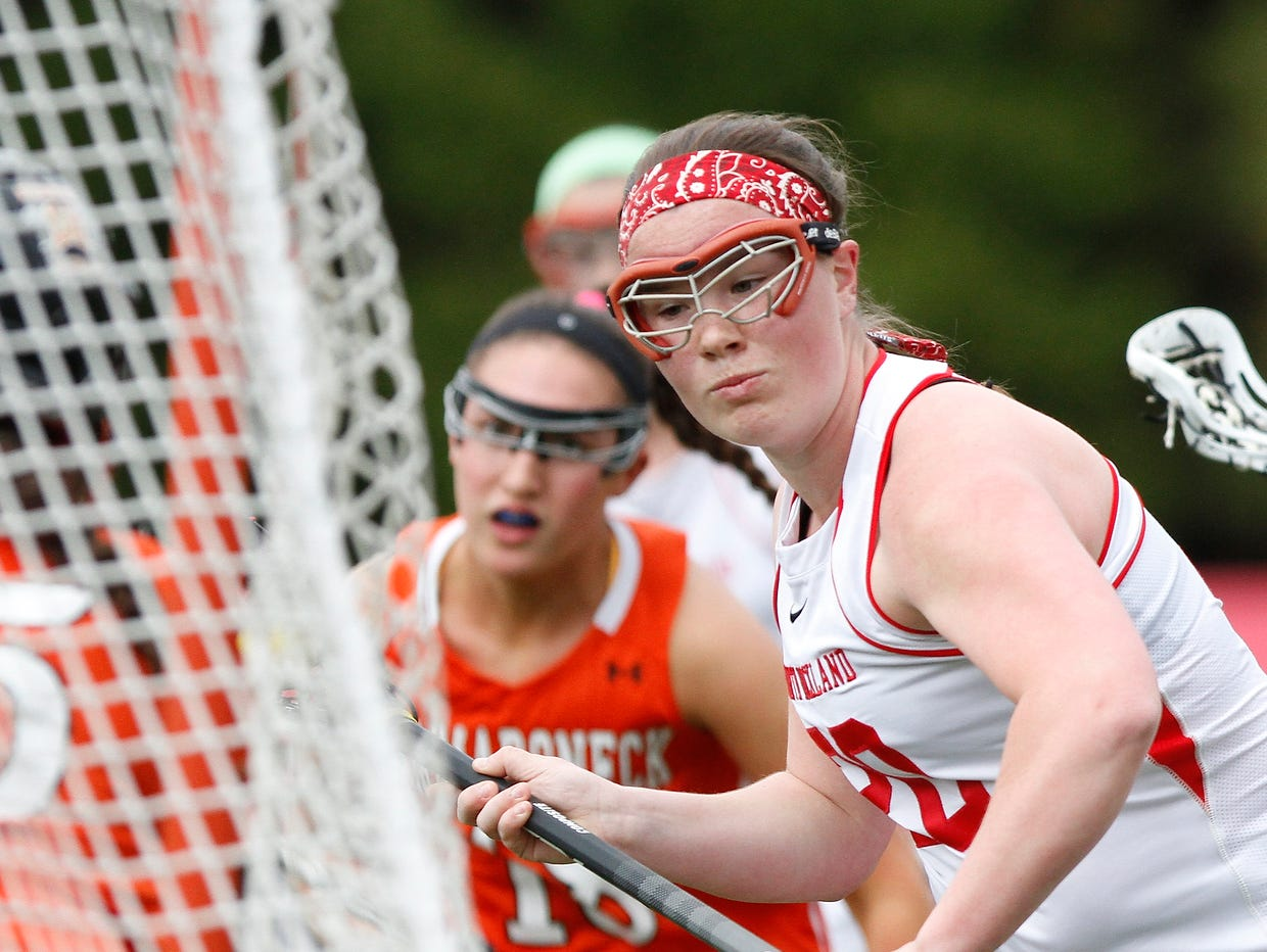 North Rockland's Kaitlyn Gutenberger (20) takes a shot on goal during a girls lacrosse game against Mamaroneck at North Rockland High School in Thiells on Saturday, April 02, 2016.