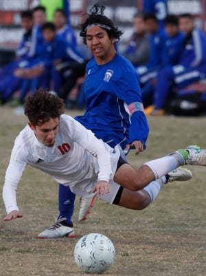 Palm Desert High School's Leonardo Garcia Guerra is fouled by a Temescal Canyon player during their CIF match at Palm Desert on February 21, 2018.