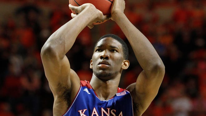 Kansas Jayhawks center Joel Embiid (21) shoots a free throw during the second half against the Oklahoma State Cowboys. Embiid was drafted to the 76ers as the third overall pick, but will likely sit out until February, if not the entire season.