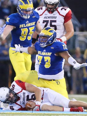 Delaware defensive lineman Blaine Woodson celebrates his sack of Richmond quarterback Kyle Lauletta in the fourth quarter of Delaware's 42-35, double overtime win at Delaware Stadium.