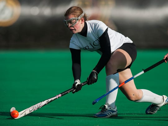 Rice's Clare Sheehan (6) hits the ball during the girls division II field hockey championship game between the U-32 Raiders and the Rice Green Knights at Moulton/Winder field on Saturday morning November 1, 2014 in Burlington, Vermont. (BRIAN JENKINS, for the Free Press)