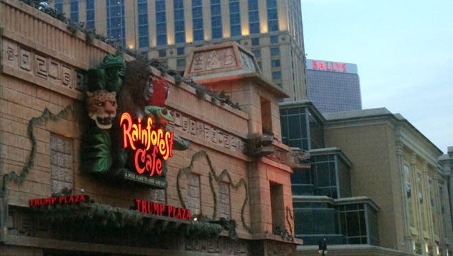 This July 24, 2014 photo shows the Rainforest Cafe on the Boardwalk in Atlantic City N.J. The cafe's owners filed a lawsuit on Sept. 5, 2014 seeking a judge to order Trump Entertainment Resorts to allow the restaurant to remain open after Trump Plaza, from which it rents space, shuts down on Sept. 16. (AP Photo/Wayne Parry)