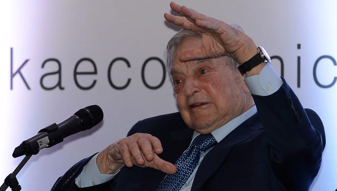 Hungarian-born U.S. magnate and philanthropist George Soros attends an economic forum in Colombo, Sri Lanka, on Jan. 7, 2016.