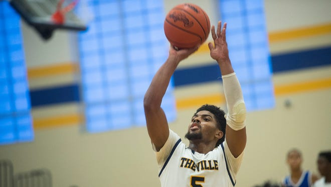 East English Village Prep point guard and Michigan signee Dave DeJulius shoots during a game against Pershing High School on Tuesday, Jan. 9, 2018 at East English Village Preparatory Academy in Detroit. East English Village Prep defeated Pershing High School 62-53.