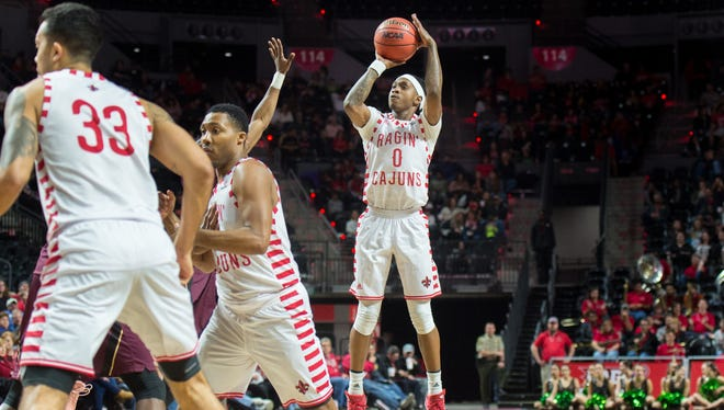 UL freshman Cedric Russell made one of the Cajuns' nine straight 3-pointers during a second-half stretch in Saturday's 82-48 win over ULM at the Cajundome.