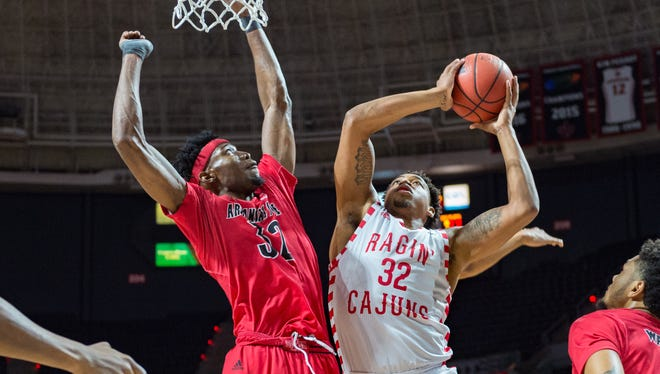 UL's Bryce Washington takes it to the basket during his 15-point, seven-rebound performance Thursday at the Cajundome.