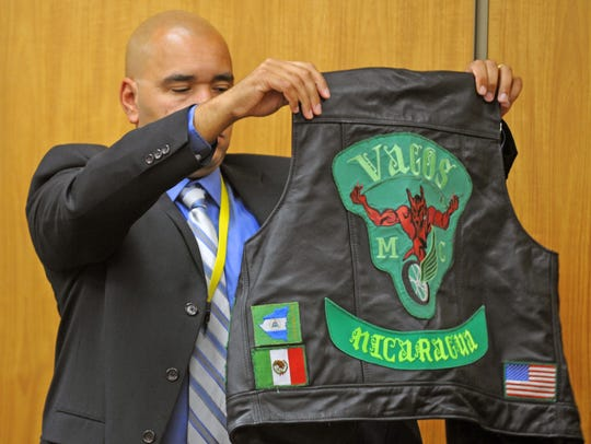 A Nevada police officer holds up a Vagos vest during