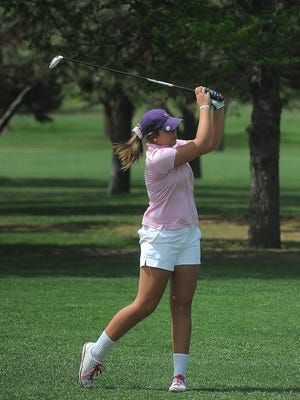 O'Gorman's Kelsey Johnson chips to the green Monday during the girls City Golf Meet at Elmwood Golf Course. Johnson won the individual title by two strokes to help O'Gorman win the team crown.