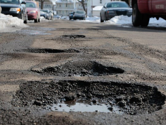 "Gov. Gretchen Whitmer is to unveil her plan to ""fix the damn roads"" in Tuesday's budget. Some say it will all be for naught unless she does something about heavy trucks."