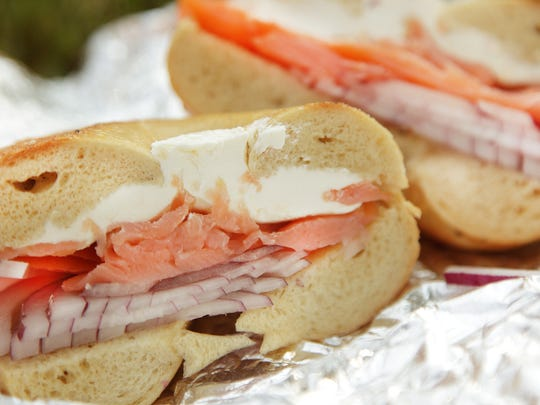A cream cheese, lox and red onion sandwich.
