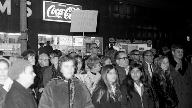 Crowds gather to observe and protest the war at the 1969 Lansing Veterans Day parade.