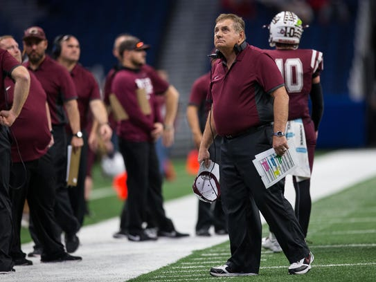 Calallen's head coach Phil Danaher looks up to the