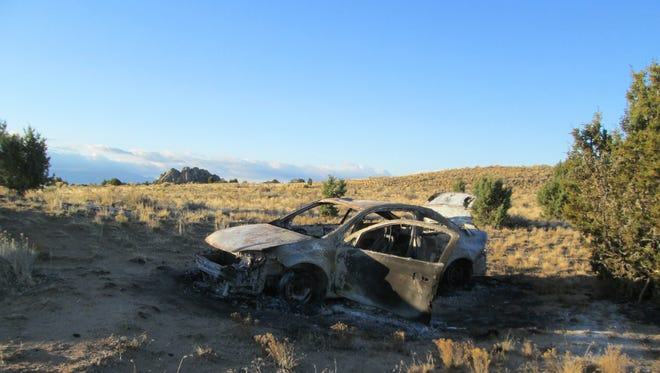 The burned remains of an allegedly stolen Chevrolet Cobalt are found near Three Peaks on Saturday, October 29, 2016.