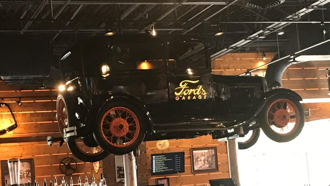 """Michigan visitors looking for a touch of home can even dine an drink at """"Ford's Garage,"""" which includes a full-sized Model T with spinning tires."""