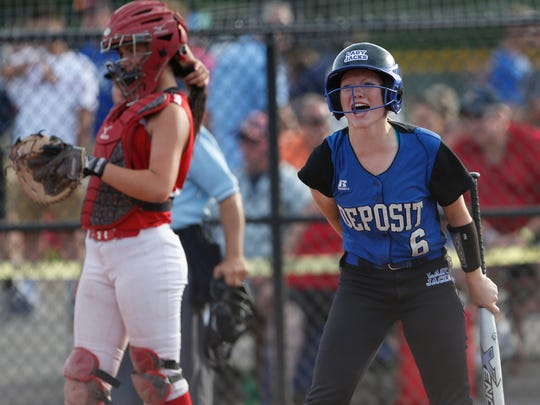 Deposit's Kyra Martin cheers on teammate, Bryn Martin rounding the bases during the Class D final against Fort Ann at the NYSPHSAA Softball Championships in Ganesvoort on June 9, 2018.