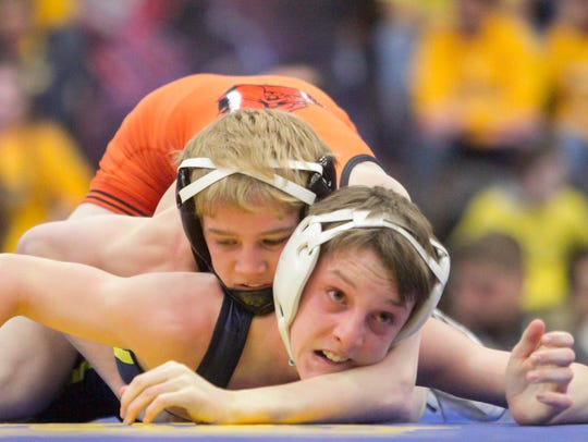 Brighton's Mason Shrader won the 103-pound class matchup