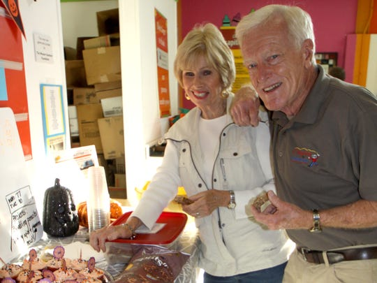 Ron Wolf and his wife Nancy, volunteers at Crayons to Computers, enjoy a Halloween celebration this past fall.