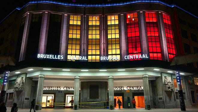 The Brussel Centraal train station is lit up in the colors of the Belgian flag on March 24, 2016.
