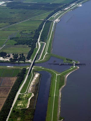 The strengthening project for the Herbert Hoover Dike, seen in this 2013 file photo, was meant to reinforce the 30-foot-high,143-mile-long dike. The project is scheduled to be finished by 2025, but President Donald Trump promised funding to Gov. Rick Scott to get it finished by 2022.