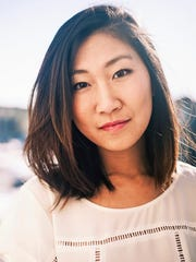 Author Lucy Tan.