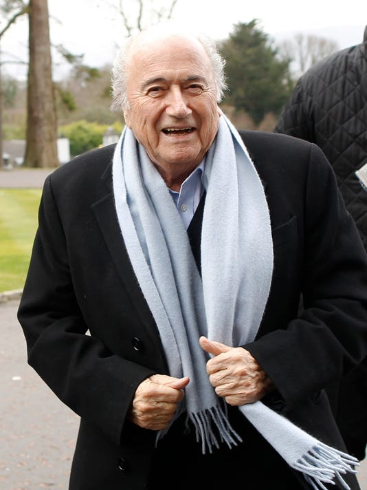President of FIFA Sepp Blatter arrives at the Culloden Hotel, Belfast, Northern Ireland, Friday, Feb. 27, 2015.  Blatter arrived for the 129th annual general meeting of The International Football Association Board that is taking place Saturday. (AP Photo/Peter Morrison)