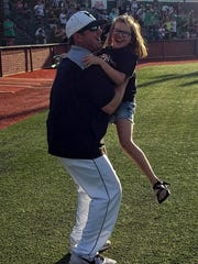 Iowa Park coach Michael Swenson and his daughter Landre embrace after the Hawks' 13-7 win over Bushland in Saturday's Game 3.