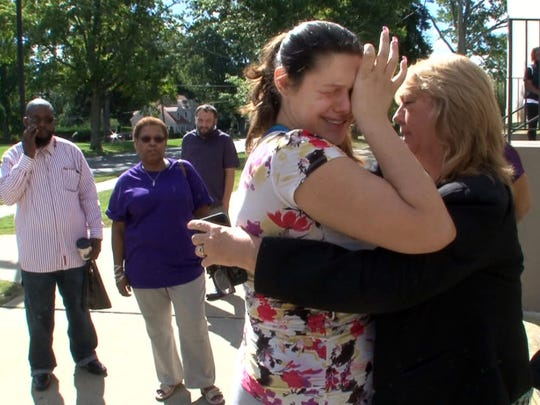 Marissa Procopio's mother Danielle Procopio is embraced outside the Monmouth County Courthouse in Freehold Friday, September 16, 2016, after Toni A. Marletta pled guilty in the hit-and-run accident that claimed the life of her daughter last year.