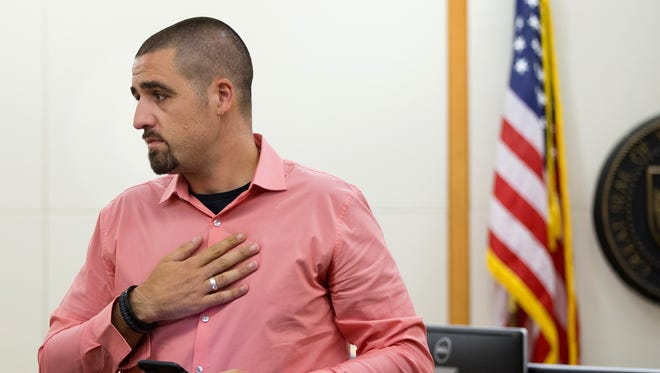 """Nick Dugas, 30, speaks during an adoption hearing at Durango Juvenile Court in Phoenix on June 8, 2018. Dugas thanked the court and expressed his feeling toward a 14-year-old boy nicknamed """"Bug"""" he met hiding in the bushes behind a business two years ago."""