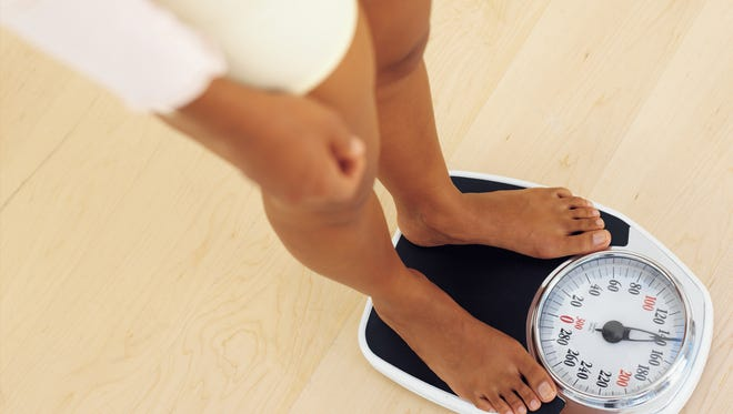 Weighing yourself daily, and keeping a record, could help you see patterns and make helpful changes, experts say.