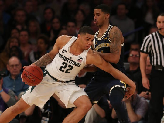 Michigan guard Charles Matthews defends against Michigan State guard Miles Bridges during their Big Ten tournament game on March 3, 2018.
