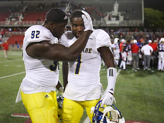 Delaware's Bilal Nichols (left) celebrates with teammate Malcolm Brown after Brown's fumble return for a touchdown was a key play in the Blue Hens' 24-20 win at LaValle Stadium Saturday.