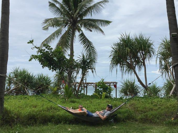 Derek and Walker Hughey relax in a hammock in Ko Lanta,