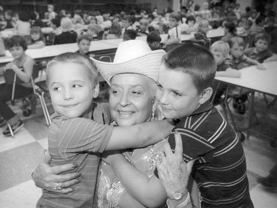 Sept 15, 1984 file photo: Former local television celebrity Sally Starr visited Oaklyn public school to recruit fans. Here she poses with Phillip Hatfield and his brother Jim.