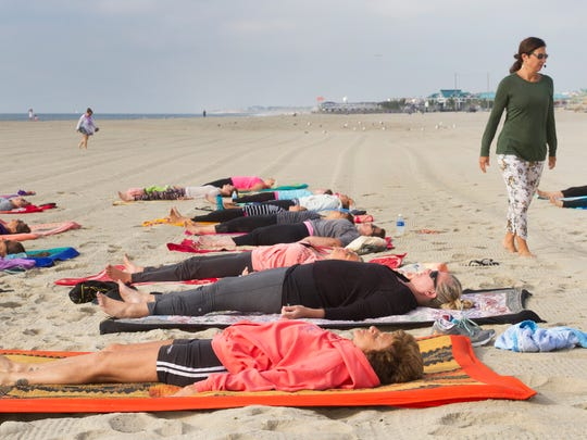 Weekend yoga class near the inlet jetty in Point Pleasant