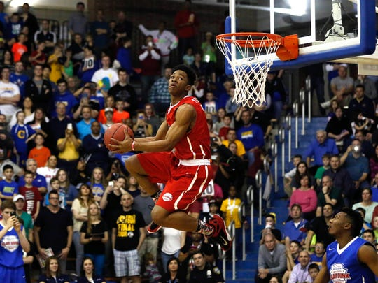 Apr 1, 2015, Carmel, IN -- Rayjon Tucker dunks the