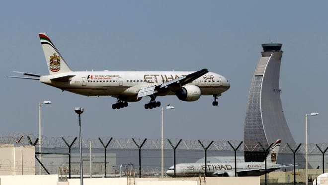 An Etihad Airways plane prepares to land at the Abu Dhabi airport in the United Arab Emirates.