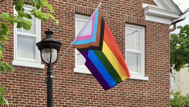 A Progress Pride Flag flies outside Novus ACS in Courthouse Square in Stroudsburg. On Thursday, PennDOT announced that they will now permit citizens to self-confirm their non-binary gender designation on state-issued identification cards.