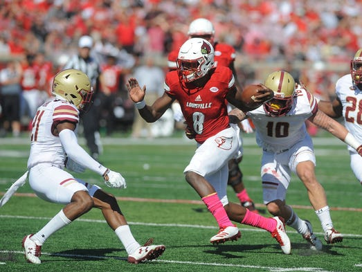 Louisville quarterback Lamar Jackson (8) runs for a