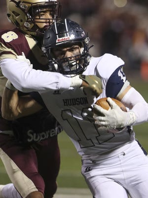 Stow-Munroe Fall's Dalen Stovall, 8, grabs Hudson Luke McLaughlin after a reception during a game last fall.
