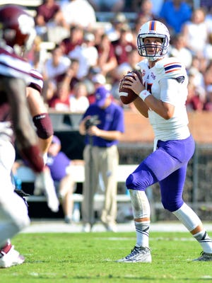 Northwestern State Demons quarterback Stephen Rivers (13) drops back to pass during the second quarter of the game against the Mississippi State Bulldogs at Davis Wade Stadium.